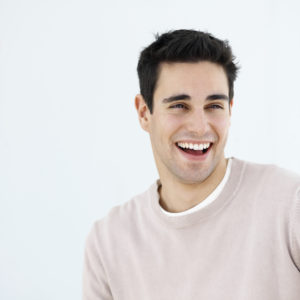 A smiling man shows how Invisalign Braces from our Redmond WA dentist straightens your smile without the Metal!