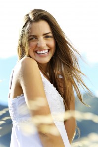 A woman smiles to show how you can give the gift of Bright Smiles with Teeth Whitening in Redmond WA