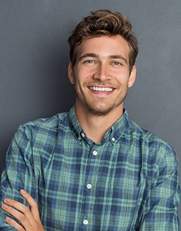 Man smiling without anyone knowing he has inlays and onlays