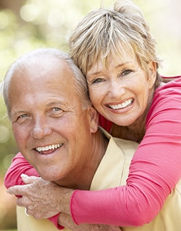 Image of a older couple laughing and smiling.