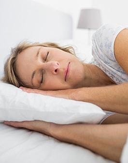 Image of sleeping woman free from sleep apnea.